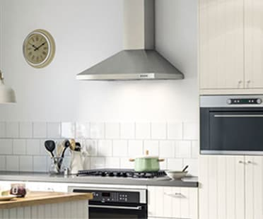 A large kitchen featuring a stainless steel extractor hood.