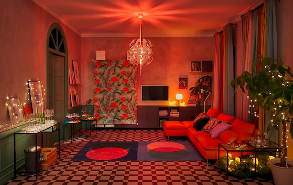 A living room set for a party with furniture along the walls, big dance floor and decorations and lighting for a club mood.