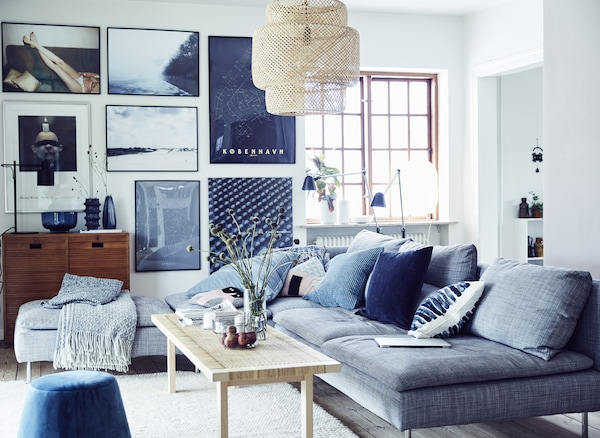 A living room with pictures on the wall.