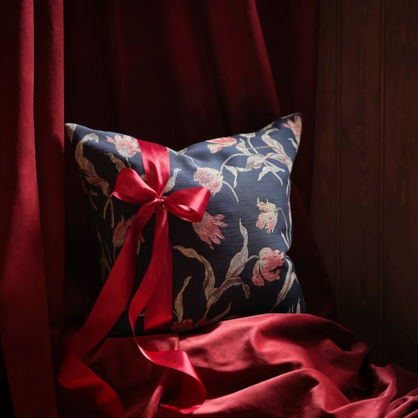 A lush, decorative cushion wrapped with a ribbon