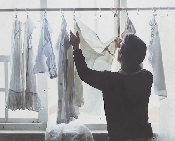 A man hanging up his clothers to dry.