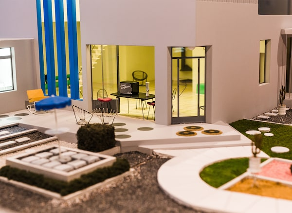 A miniature model of a home and outdoor space.