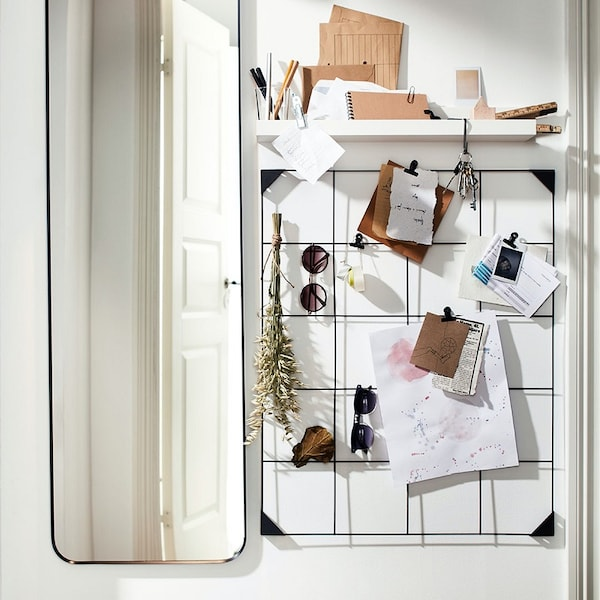 A mirror and a notice clip board to organize your daily life.