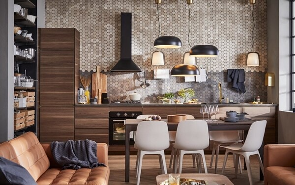 A modern open space kitchen with IKEA VOXTORP dark brown kitchen cabinet door fronts, with a walnut effect in the wood grain.