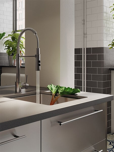 A modern style faucet running water into a sink