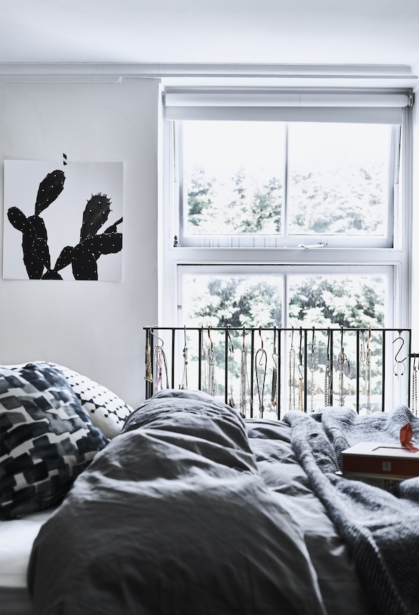 A monochrome bedroom with grey bedding.