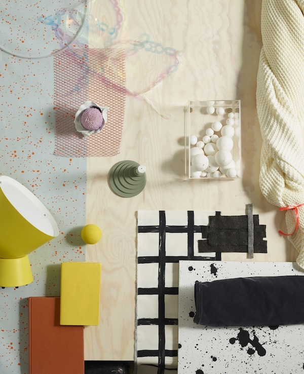 A moodboard of yellow, black and white colours and materials like soft cotton and natural pine wood.