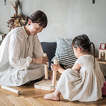 A mother and her child are assembling furniture.