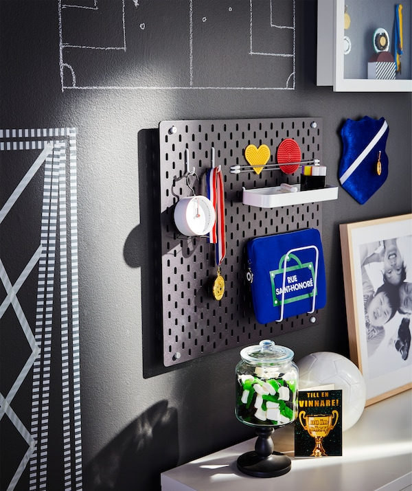 A pegboard used to keep World Cup watching essentials like first aid kit, medals, timer and playful penalty cards in place.