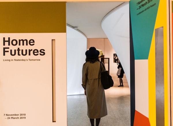 A person entering the Home Futures exhibition.