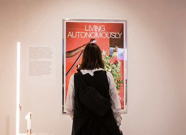 A person looking at a poster titled 'Living autonomously'.