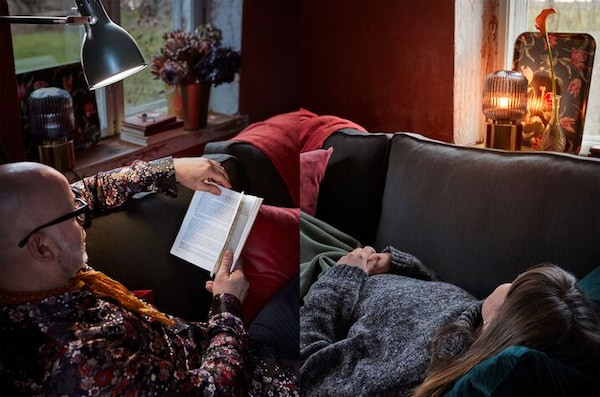 A person reading and a person comfortably lying down are at each ends of a sofa.