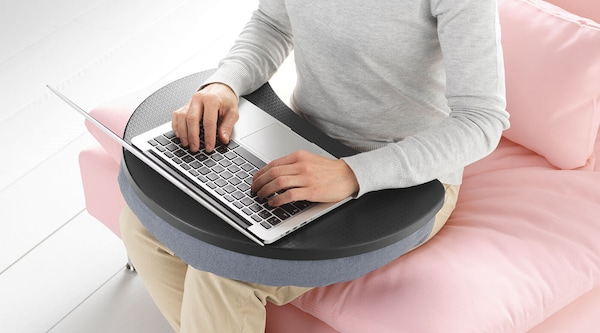 A person typing on a laptop computer