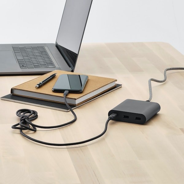 A phone being charged using the LILLHULT USB type C to lightning cord in dark grey