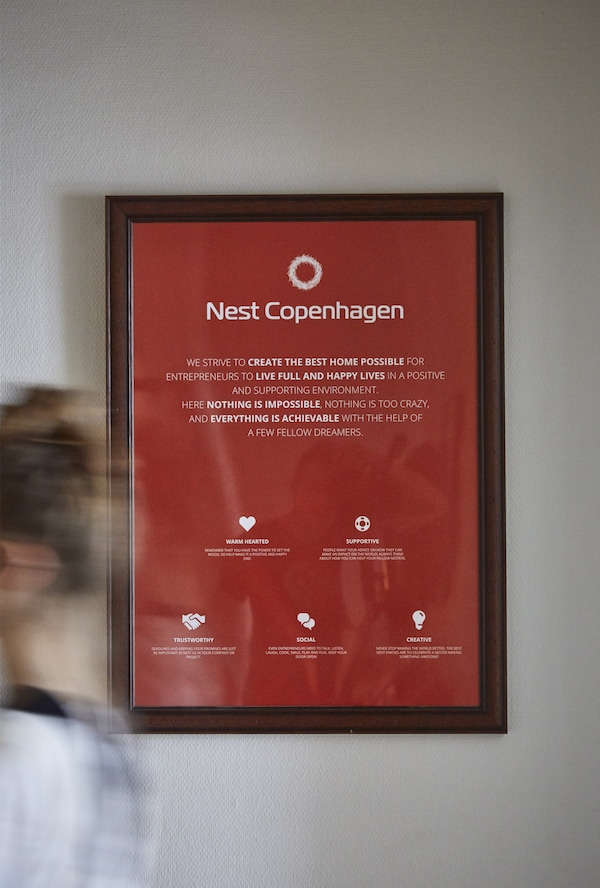 A picture frame with Nest manifesto poster.