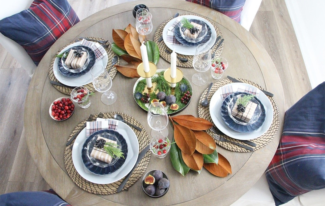 A picture of a festive table setting with centerpieces