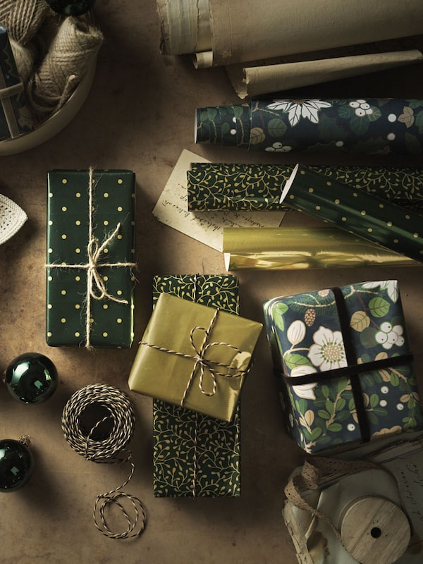 a pile of neatly wrapped gold and green gifts.