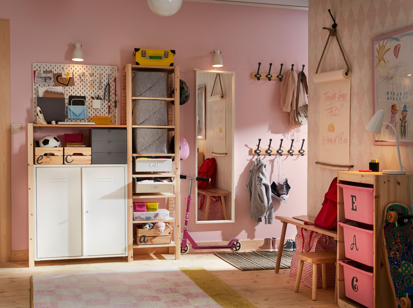 A pink and white hall with a practical IVAR combination of three elements in combination with storage cabinets, wall shelves and a white SKÅDIS pegboard.