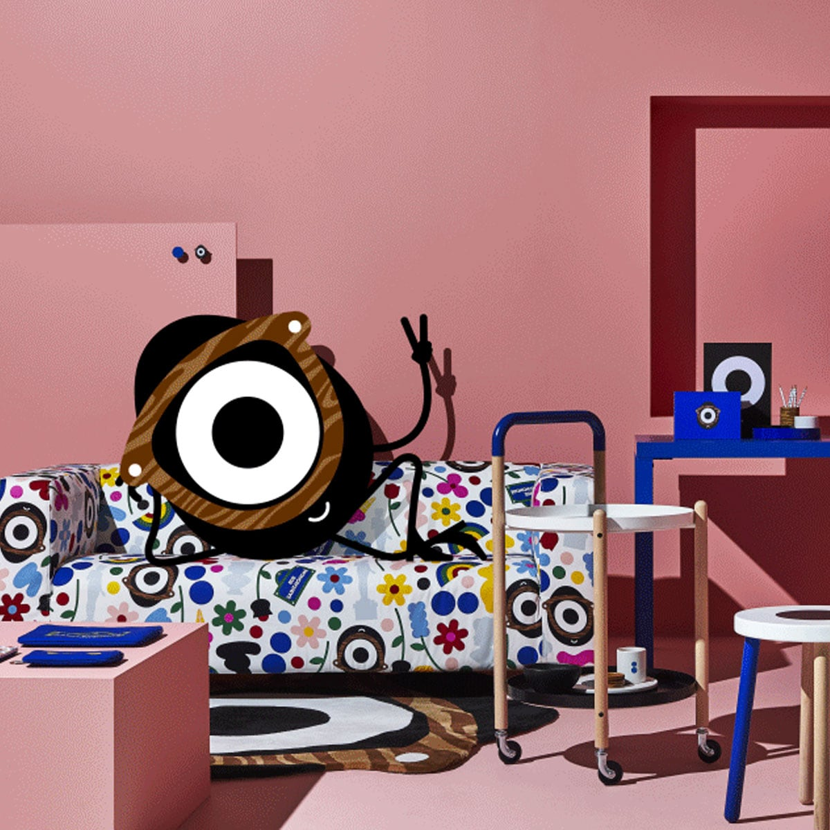 A playful living room with pink walls showing the animated Darcel Disappoints relaxing in FÖRNYAD sofa.