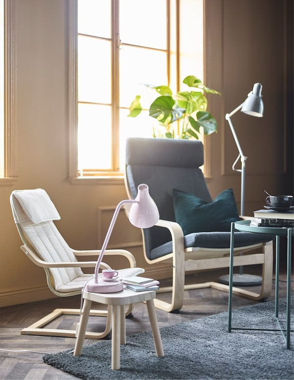 A POÄNG kid's chair and matching adult's chair in a family-friendly living room.