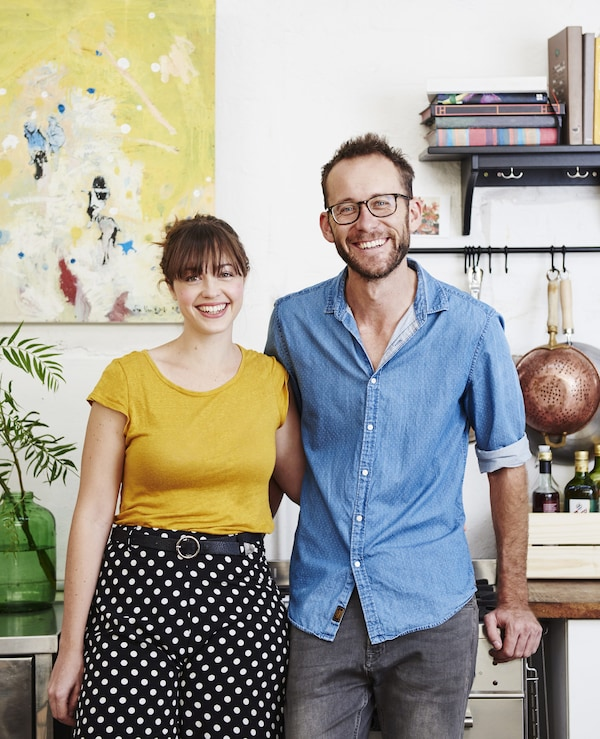 A portrait of Kyra and Dave in their kitchen.