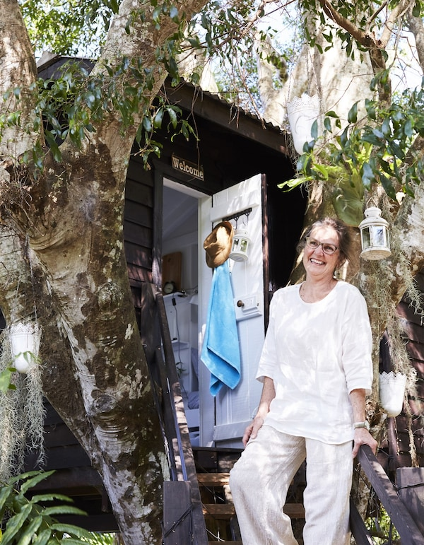A portrait of Margaret outside the tree house.