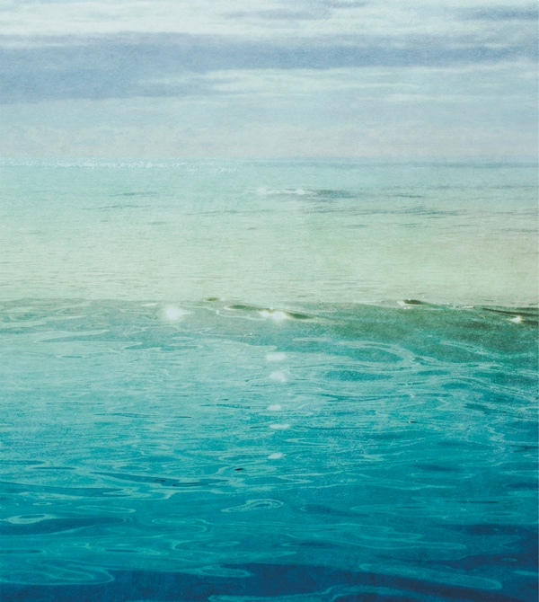 A print of a blue sea sparkling in the sun.