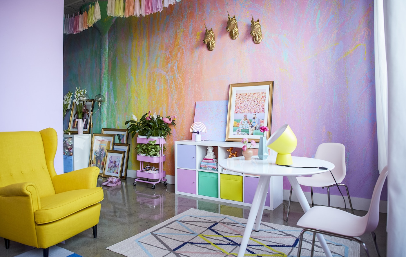 A rainbow coloured living room and dining area.