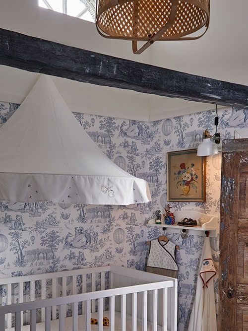 A RÖDHAKE bed canopy is attached to the wall above a white SUNDVIK cot in a child's shabby chic bedroom.
