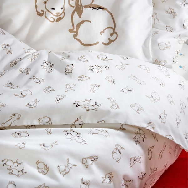 A RÖDHAKE quilt cover printed with a rabbit pattern on a light-coloured background.