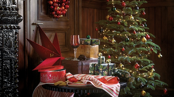 A room featuring a table with IKEA vinter collection products next to a Christmas tree