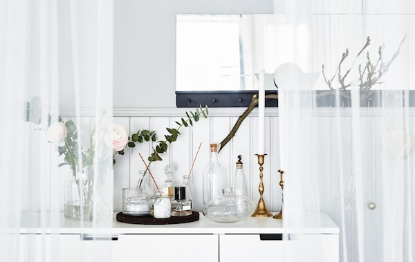 A scent station with candles , flowers and perfumes. What's your dream bedroom?