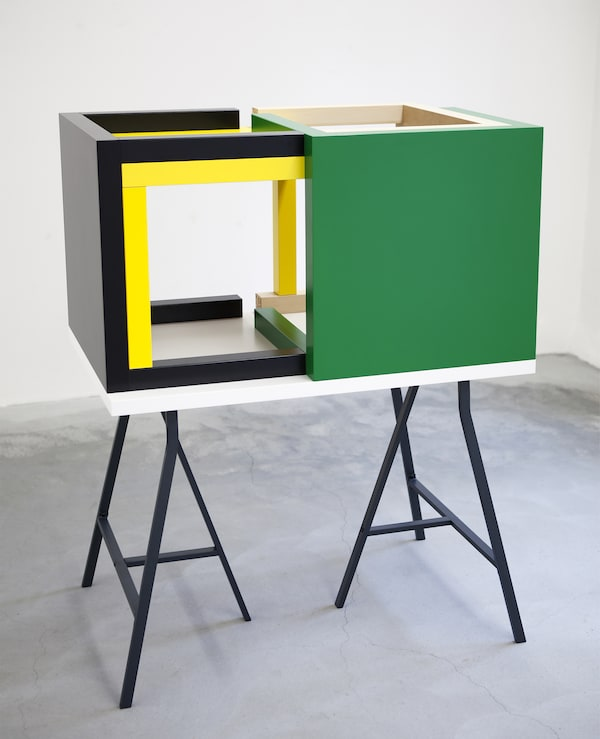 A sculpture made from a collection of IKEA tables.