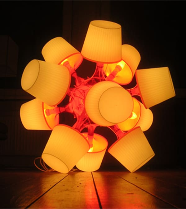 A sculpture made from IKEA lamps.