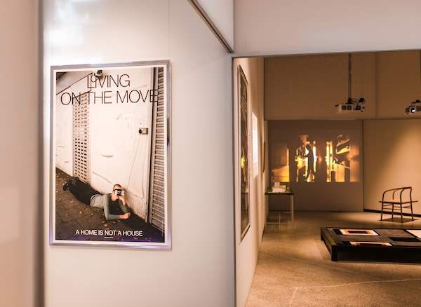 A section of an exhibition space with a poster entitled 'Living on the move' on the wall.