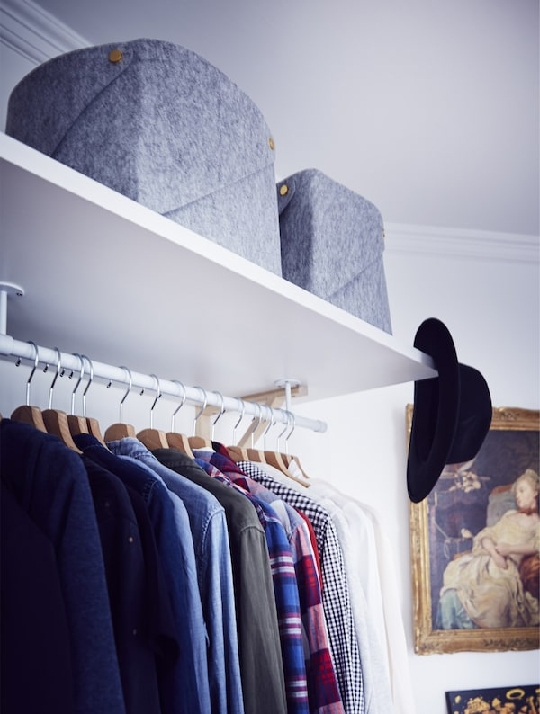A section of open wardrobe and storage.