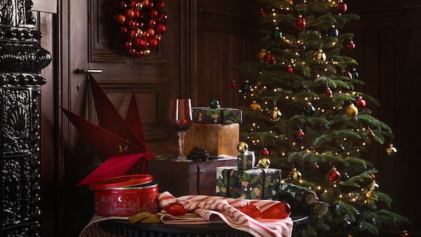 A selection of products from the IKEA VINTER 2020 range, including a holiday tree, gift wrap and home accessories.