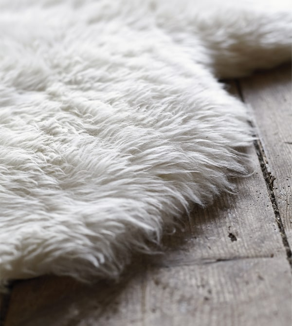 A sheepskin throw can be a fuzzy, soft rug. RENS sheepskin from IKEA is white wool that's soil-repellent and hard-wearing for lots of comfy nights and mornings underfoot.