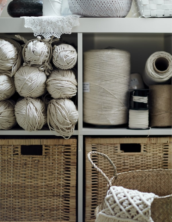 A shelving unit and drawers filled with thread.
