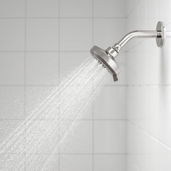 A showerhead spraying water.