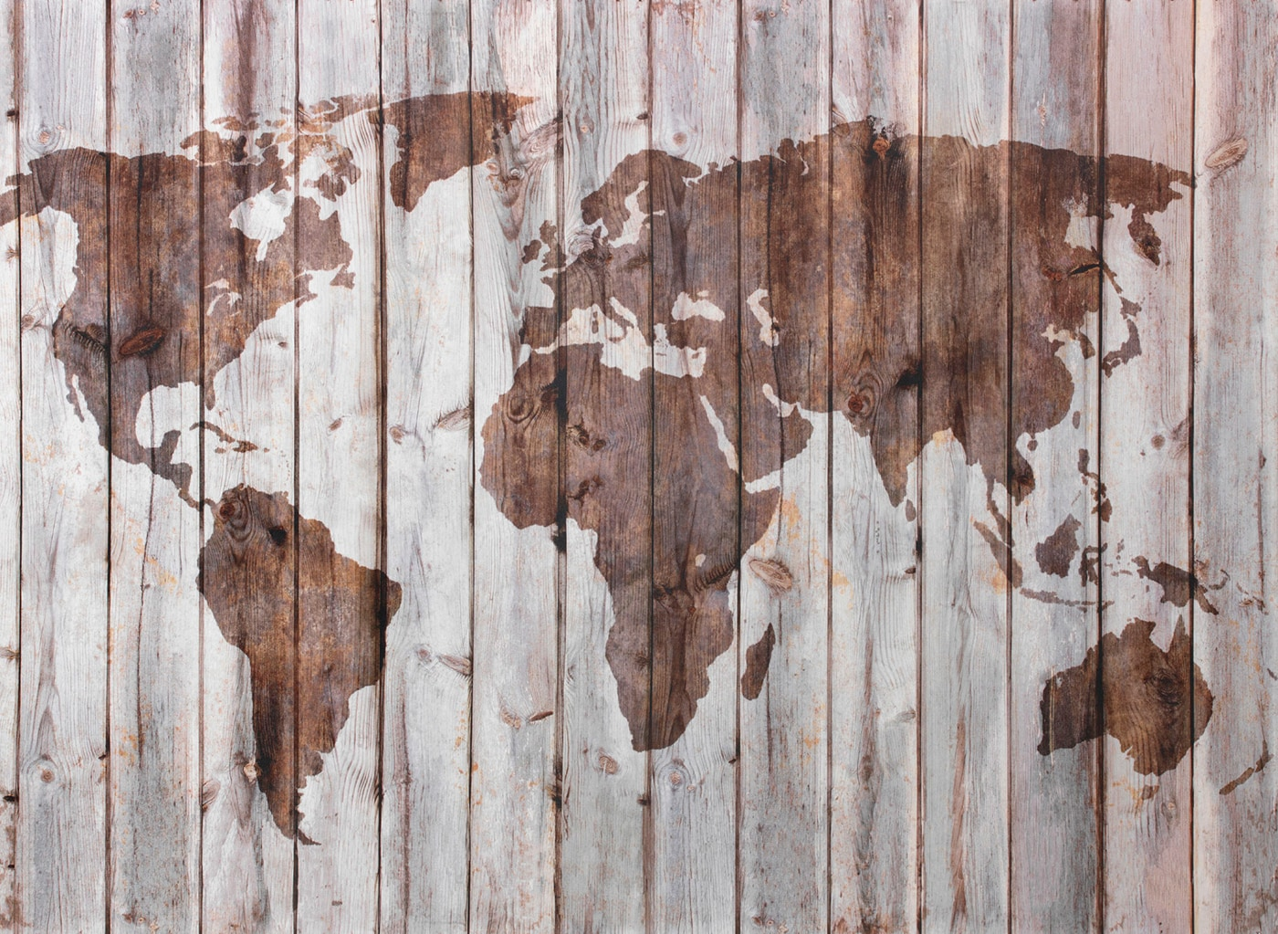 A silhouette of the world on a wooden wall, symbolizing that IKEA is a global brand with many products made from wood.