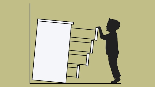 A sketch of a chest of drawers, not secured to a wall, tipping over on a child who has pulled out all the drawers.