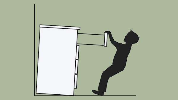 A sketch of a chest of drawers, which is not secured to a wall, tipping over on a child who is pulling on a drawer.