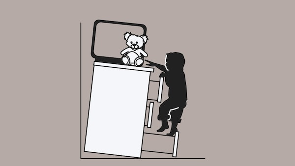 A sketch of an unsecured dresser, with a TV and toy on top, tipping over on a child climbing up the drawers.