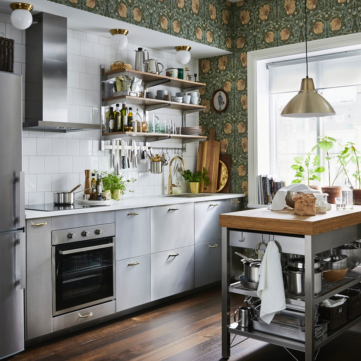 A small, brown and grey kitchen with traditional wallpaper and contemporary GREVSTA drawer fronts in stainless steel.