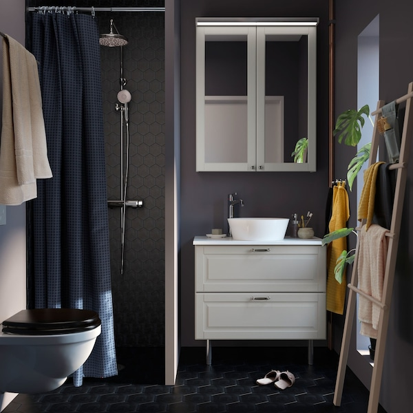 A small dark grey bathroom with white GODMORGON bathroom cabinet, TOLKEN countertop and KATTEVIK white bowl sink.