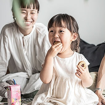 A small girl eating.
