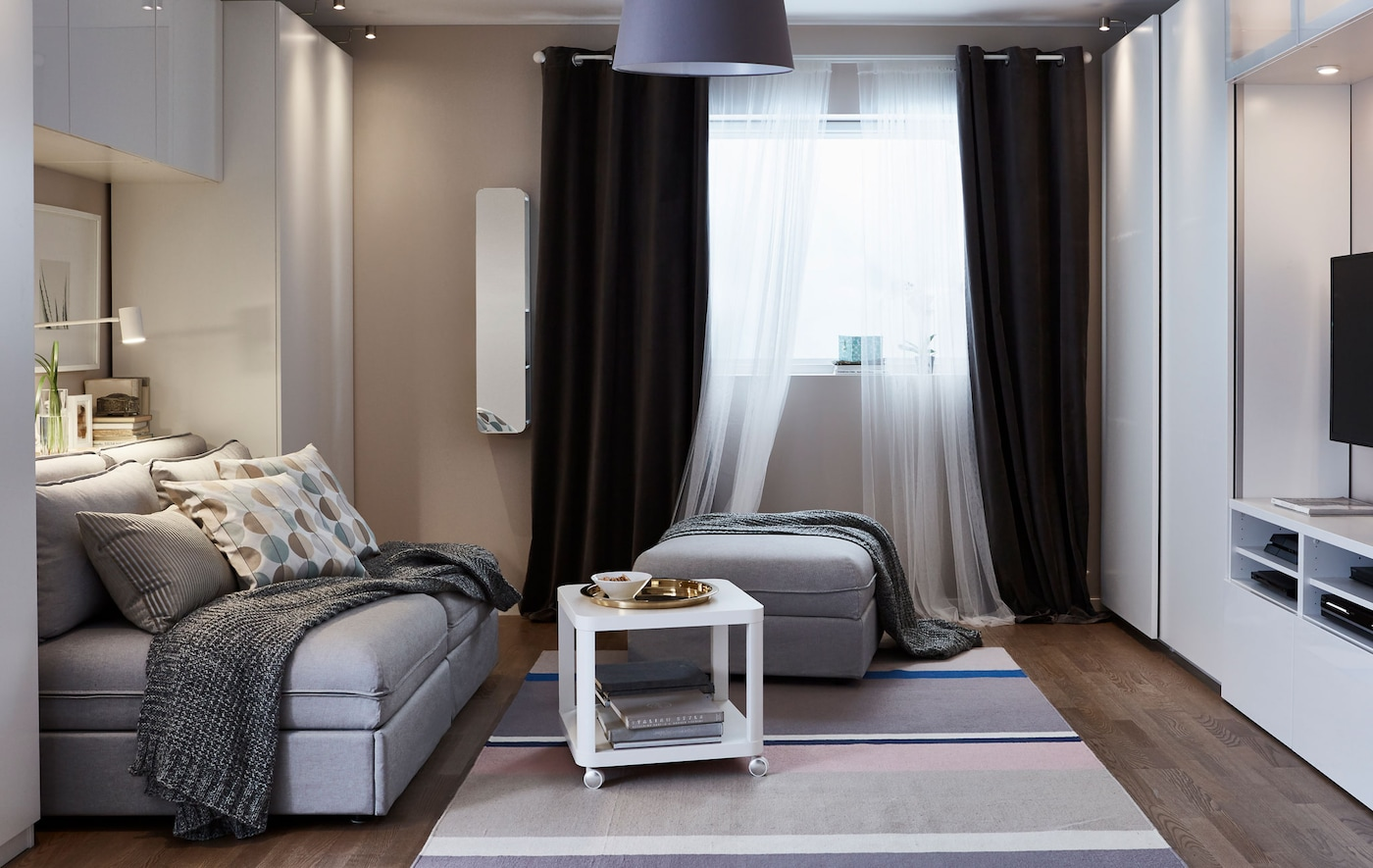 A small living room is set up in its living room function.
