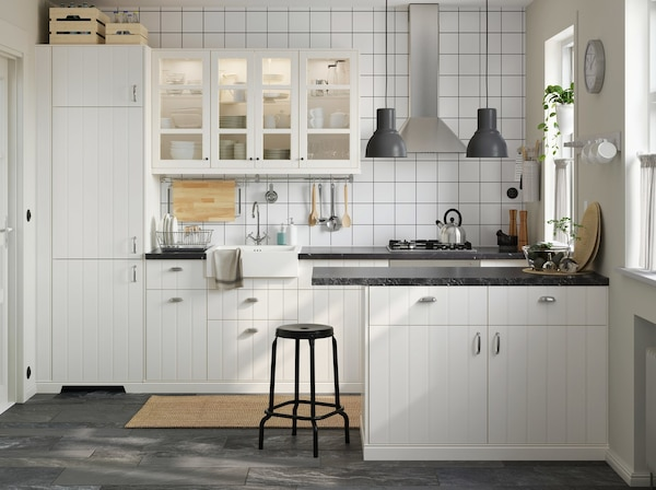A small white kitchen with IKEA METOD white kitchen cabinet and HITTARP glass doors to create an airy space.