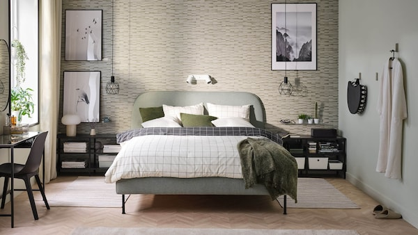 A soft bed surrounded by IKEA furniture, plants, decor, accessories and more